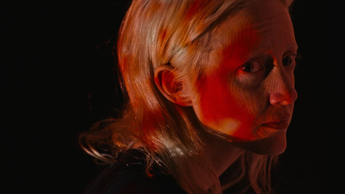 Tasya (Andrea Riseborough) bathed in red light in Possessor