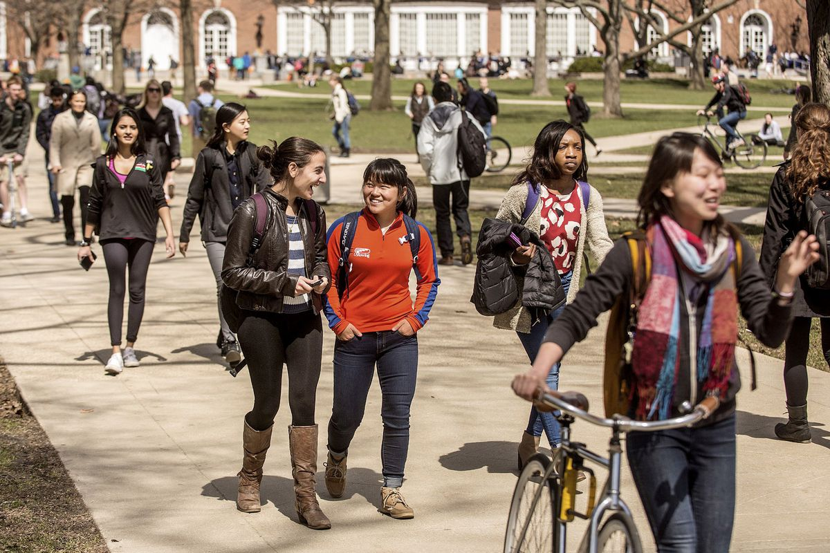 Students walk across the Quad on the University of Illinois campus in Urbana, Ill.