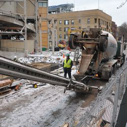 Another view of the system being used to transfer the concrete to the bleachers