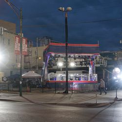 The FOX Sports stage lights also blinding motorists heading east on Waveland Avenue and north on Sheffield Avenue