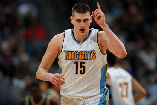Denver Nuggets forward Nikola Jokic, of Serbia, gestures after hitting a key basket as he drops back on defense against the Milwaukee Bucks late in the second half of an NBA basketball game Friday, Feb. 3, 2017, in Denver. The Nuggets won 121-117. (AP Photo/David Zalubowski)