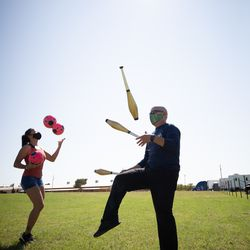 Julio Rosales, 51, and his daughter Doricela, 20, practice juggling outside their RV parked in Stephenville, Texas. Julio is a juggler in a circus, but because the circuses are shut down, he is doing whatever odd jobs at fairs and carnivals that he can pick up. He's currently selling cotton candy at a carnival at a shopping center.