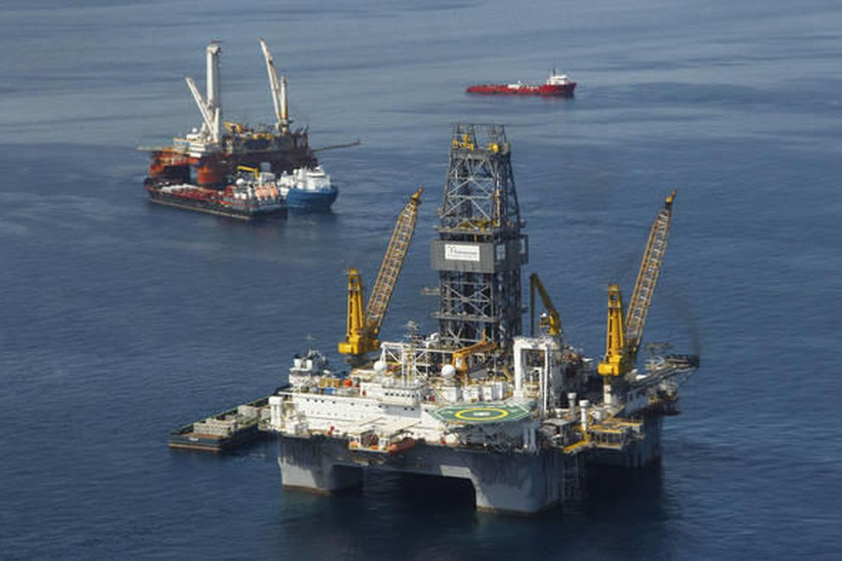 This file photo made Aug. 3, 2010, shows the Development Driller III, which is drilling the primary relief well, and the Helix Q4000, background left, the vessel used to perform the static kill operation, at the site of the Deepwater Horizon Oil Spill in