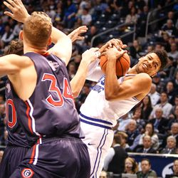 Brigham Young Cougars forward Yoeli Childs (23) has the ball knocked back into his arms after a shot by Saint Mary's Tanner Krebs (00) as the BYU Cougars take on the Saint Mary's Gaels in the Marriott Center in Provo on Saturday, Dec. 30, 2017.