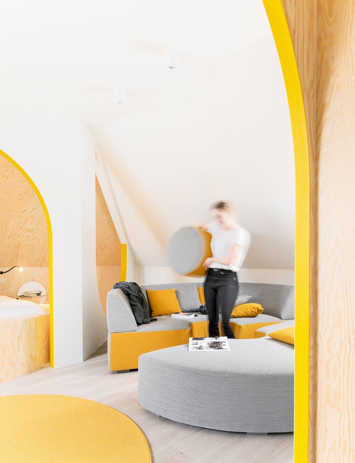 A round, reconfigurable sofa.