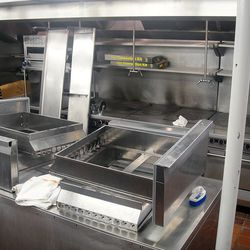Some of the old stoves are in place, framed by the new toys for Chef Abrams