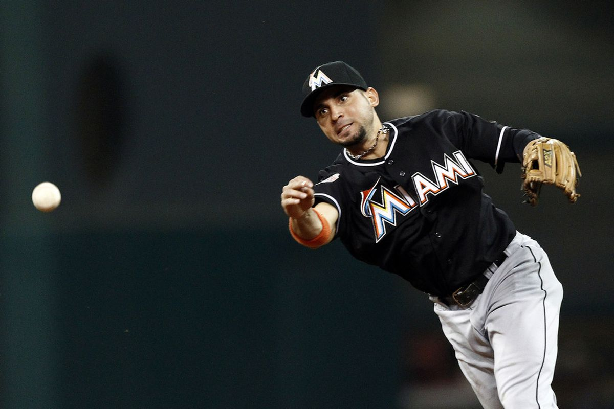 HOUSTON,TX - MAY 08: Omar Infante #12 of the Miami Marlins throws wildly to first base allowing two Houston Astros runners to score in the sixth inning on May 8, 2012 at Minute Maid Park in Houston, Texas. (Photo by Bob Levey/Getty Images)