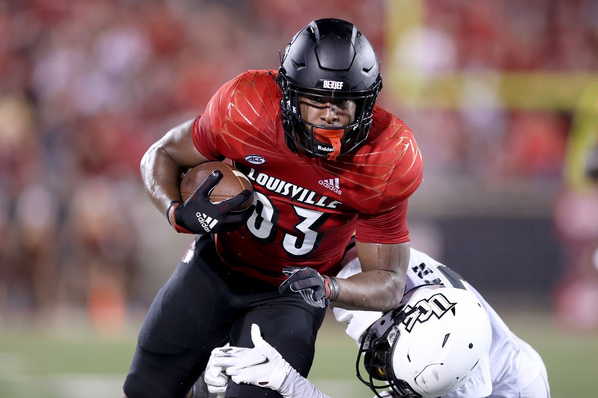 Marshon Ford of the Louisville Cardinals runs with the ball after catching a pass for a touchdown against the UCF Knights at Cardinal Stadium on September 17, 2021 in Louisville, Kentucky.