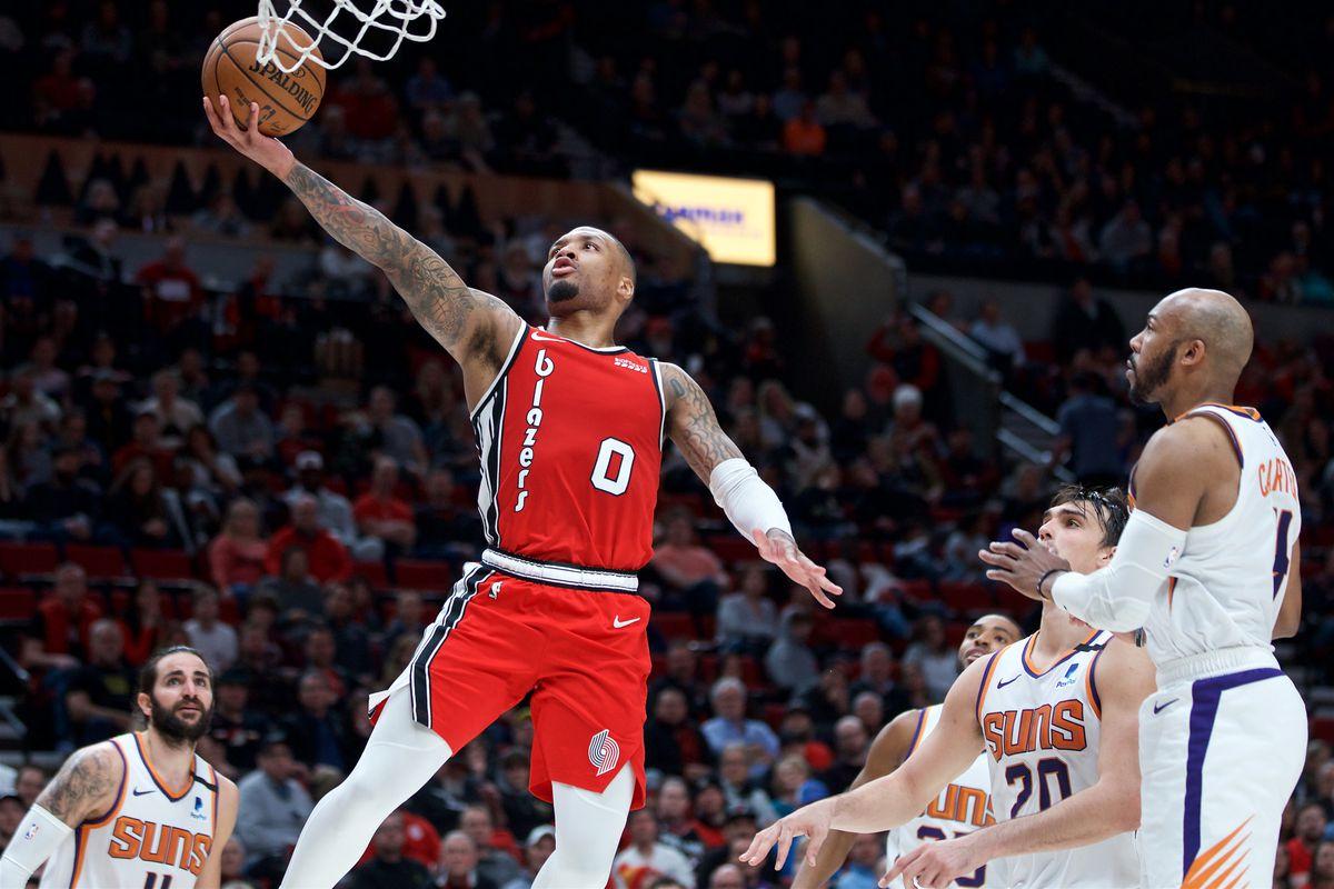 Portland Trail Blazers guard Damian Lillard shoots over Phoenix Suns forward Dario Saric during the fourth quarter at the Moda Center.