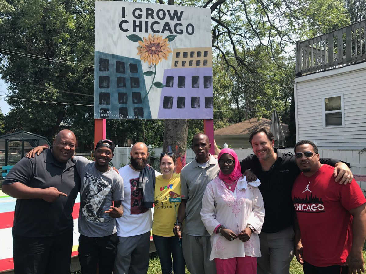 """Marcus Robinson, left,managing director of Collaboraction Theatre, and Erin Vogel (in yellow shirt), co-executive director of I Grow Chicago, and supporters join Wu-Tang's Tareef Michael (white shirt) and Oliver """"Power"""" Grant (grey shirt).   Provided phot"""