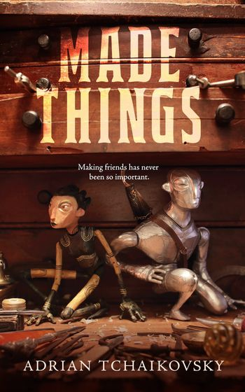 made things cover with two wooden puppets hiding on a workshop table