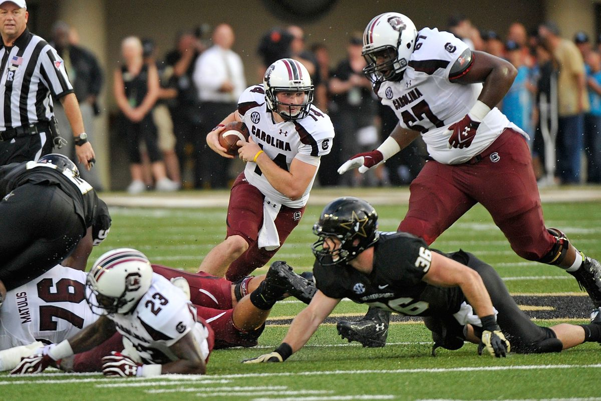 NASHVILLE, TN - AUGUST 30:  Quarterback Connor Shaw #14 of the South Carolina Gamecocks runs against the Vanderbilt Commodores at Vanderbilt Stadium on August 30, 2012 in Nashville, Tennessee.  (Photo by Frederick Breedon/Getty Images)