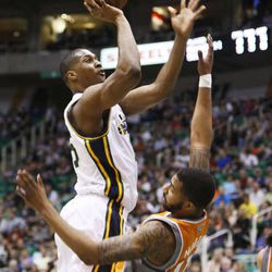 Utah's Derrick Favors is called for an offensive foul on a shot over Markeiff Morris as the Utah Jazz and the Phoenix Suns play Wednesday, March 27, 2013 in Energy Solutions arena.