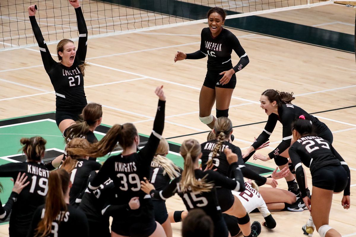 Lone Peak celebrates its win over Copper Hills in the 6A volleyball championship match at Hillcrest High School.