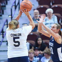 Maria Conlon puts up a shot over Carla Berube.
