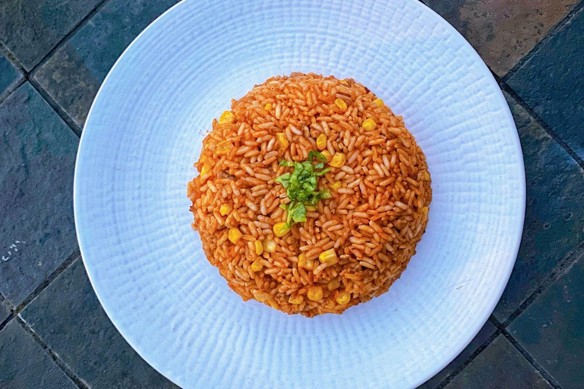 jollof rice in a circle on a white plate