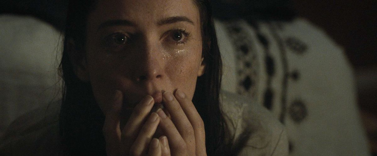 Rebecca Hall in The Night House, looks up in horror