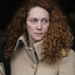 Rebekah Brooks, the former chief of News Corp.'s British operations, leaves the Old Bailey court in London London, Wednesday, Sept. 26, 2012. Rebekah Brooks and Andy Coulson, the ex-communications chief for Prime Minister David Cameron, learned Wednesday that they will face trial next September over allegations linked to phone hacking.
