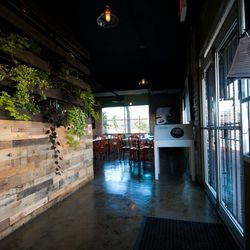The entrance to Eat. To the left, an herb garden grows.