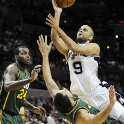 San Antonio Spurs' Tony Parker (9), of France, shoots over Utah Jazz's Devin Harris and Paul Millsap (24) during the second half of an NBA basketball game, Sunday, April 8, 2012, in San Antonio.