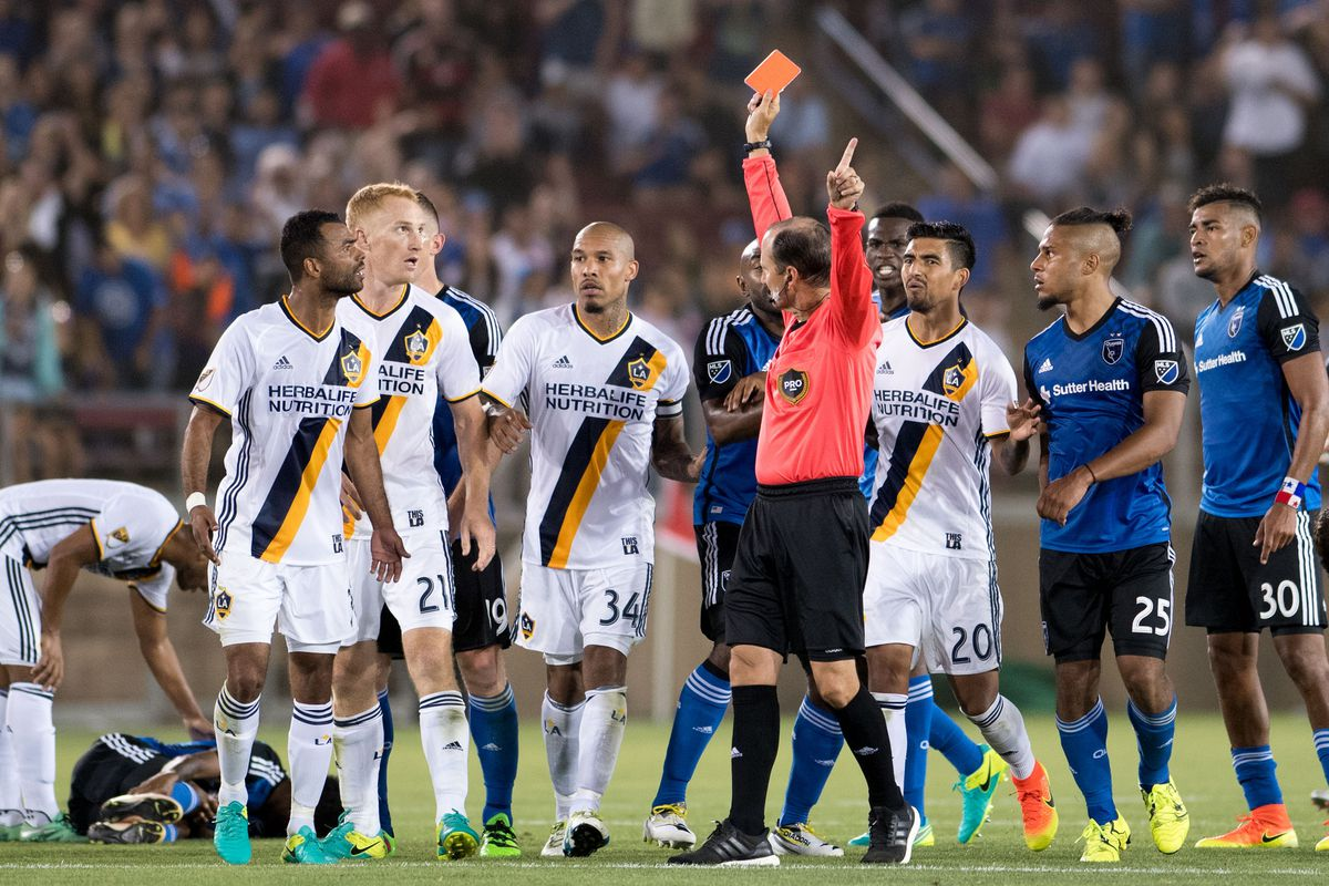 Referee Kevin Stott, shown here ejecting Ashley Cole, should have issued a card to those in the crowd using offensive language
