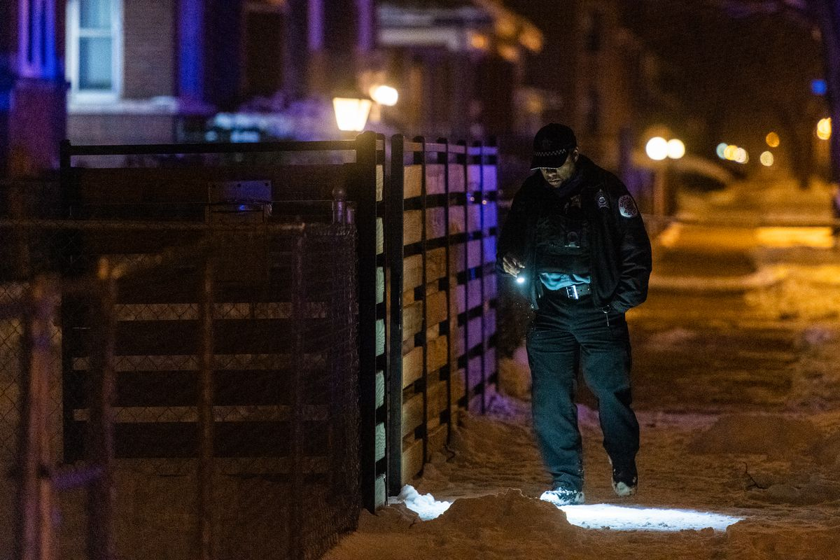 Police investigate the scene where 3 people were shot, Tuesday morning, in the 9000 block of South Bishop in the Brainerd neighborhood.   Tyler LaRiviere/Sun-Times