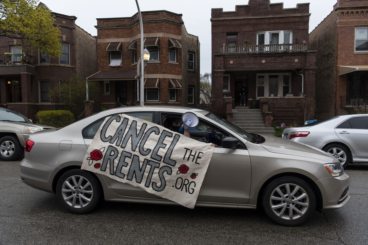 Nick Stender chats for a rent freeze during a vehicle caravan protest Saturday in Albany Park.