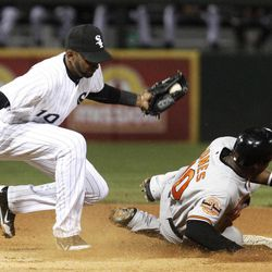 Chicago White Sox shortstop Alexei Ramirez catches Baltimore Orioles' Adam Jones stealing second on a throw from catcher A.J. Pierzynski during the fourth inning of a baseball game, Wednesday, April 18, 2012, in Chicago.
