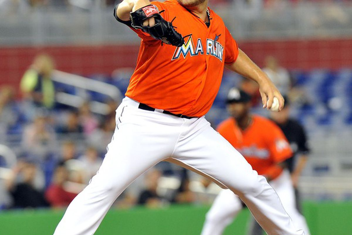 April 30, 2012; Miami, FL, USA; Miami Marlins starting pitcher Mark Buehrle (56) throws during the first inning against the Arizona Diamondbacks at Marlins Park. Mandatory Credit: Steve Mitchell-US PRESSWIRE