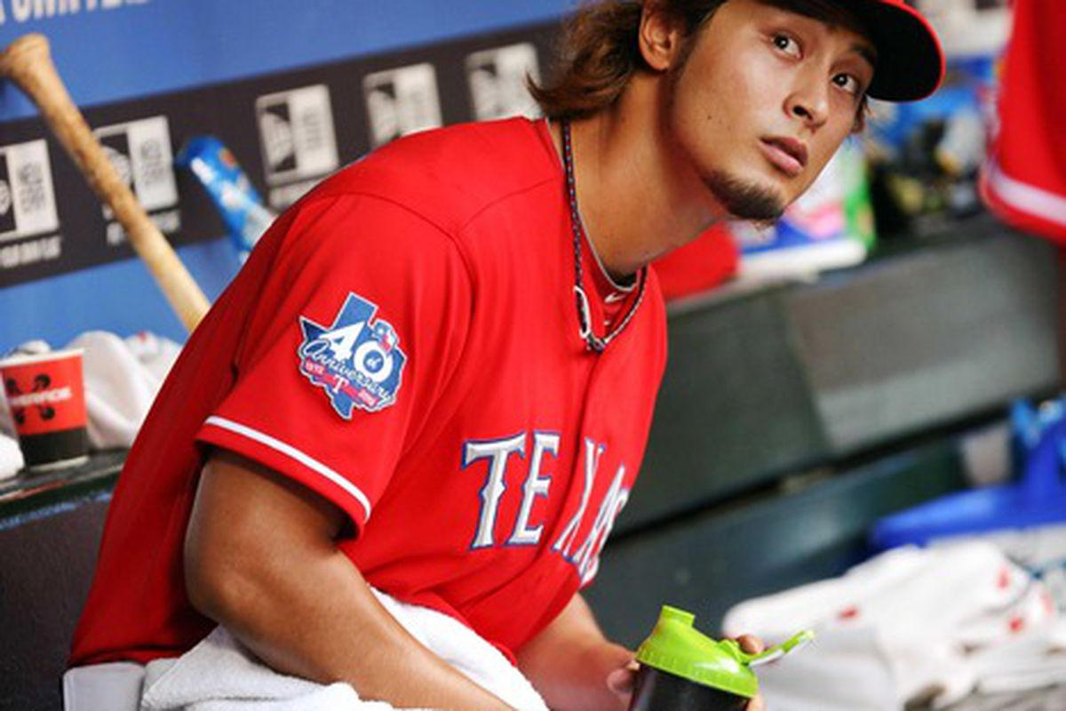 May 16, 2012; Arlington, TX, USA; Texas Rangers starting pitcher Yu Darvish (11) watches from the dugout during the fourth inning against the Oakland Athletics at Rangers Ballpark.  Mandatory Credit: Kevin Jairaj-US PRESSWIRE