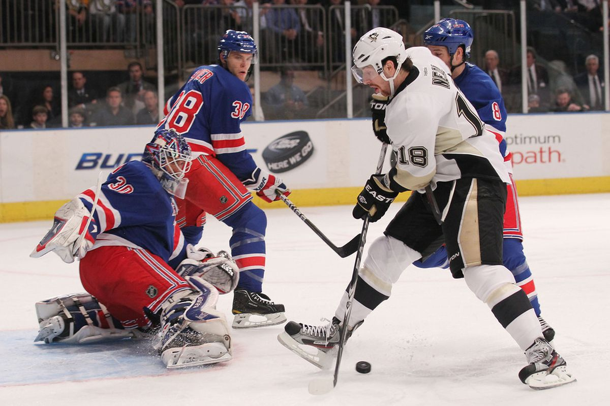 NEW YORK, NY - NOVEMBER 29: James Neal #18 of the Pittsburgh Penguins shoots the puck against Henrik Lundqvist #30 of the New York Rangers at Madison Square Garden on November 29, 2011 in New York City.  (Photo by Nick Laham/Getty Images)