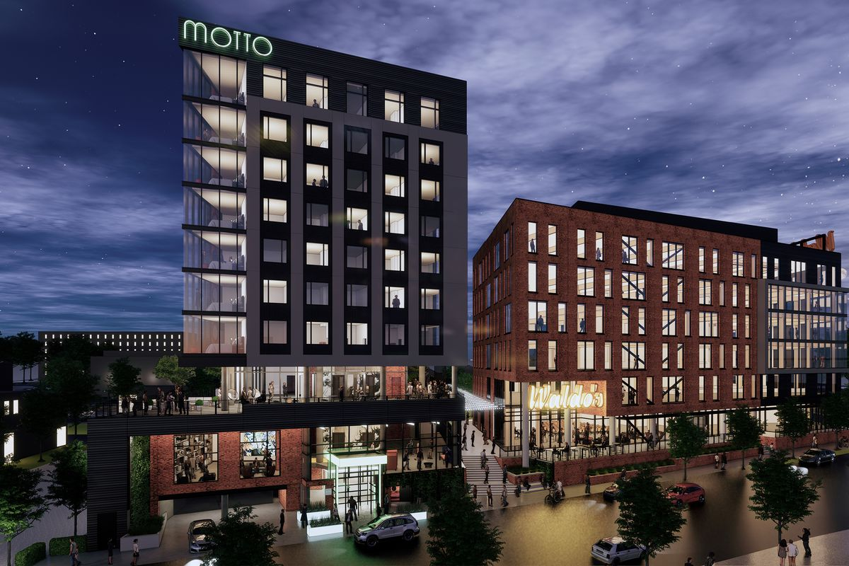 """A rendering shows a hotel with the word """"MOTTO"""" on the top in bright white letters, flanked by a smaller mixed-use building."""