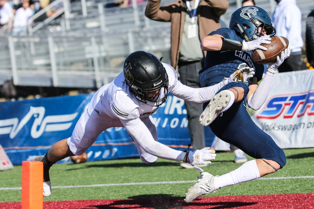 Corner Canyon's Cody Hagen (3) runs the ball and dives into the end zone for a touchdown in the 6A football state championship game.