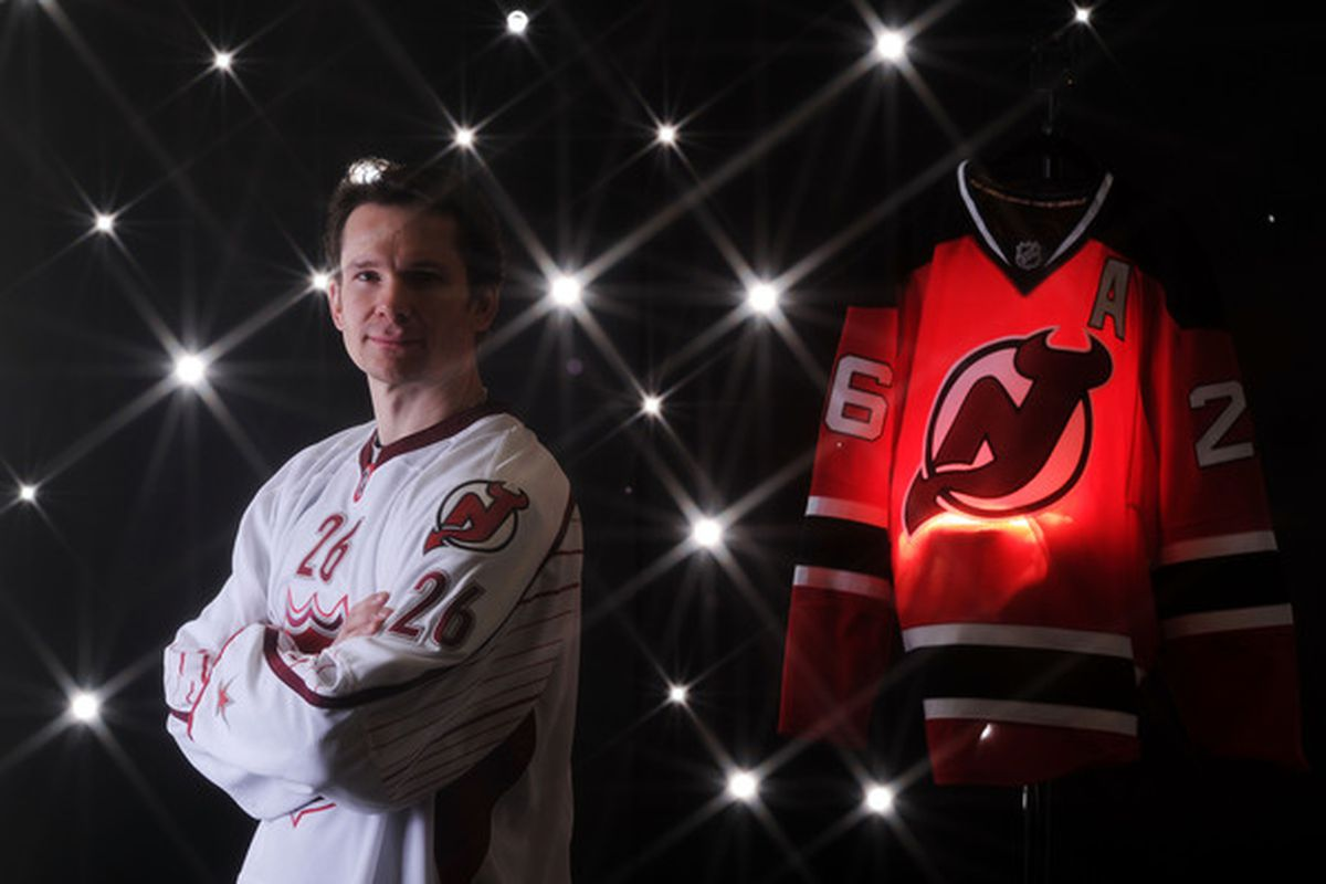 Patrik Elias will play tonight. Here's a picture that proves that he could wear a Rick Martel-ian button.  (Photo by Harry How/Getty Images)