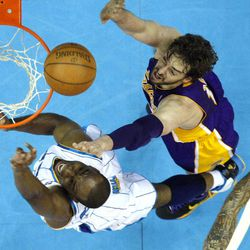 New Orleans Hornets power forward Carl Landry, left, drives to the basket against Los Angeles Lakers power forward Pau Gasol in the first half of an NBA basketball game in New Orleans, Monday, April 9, 2012.