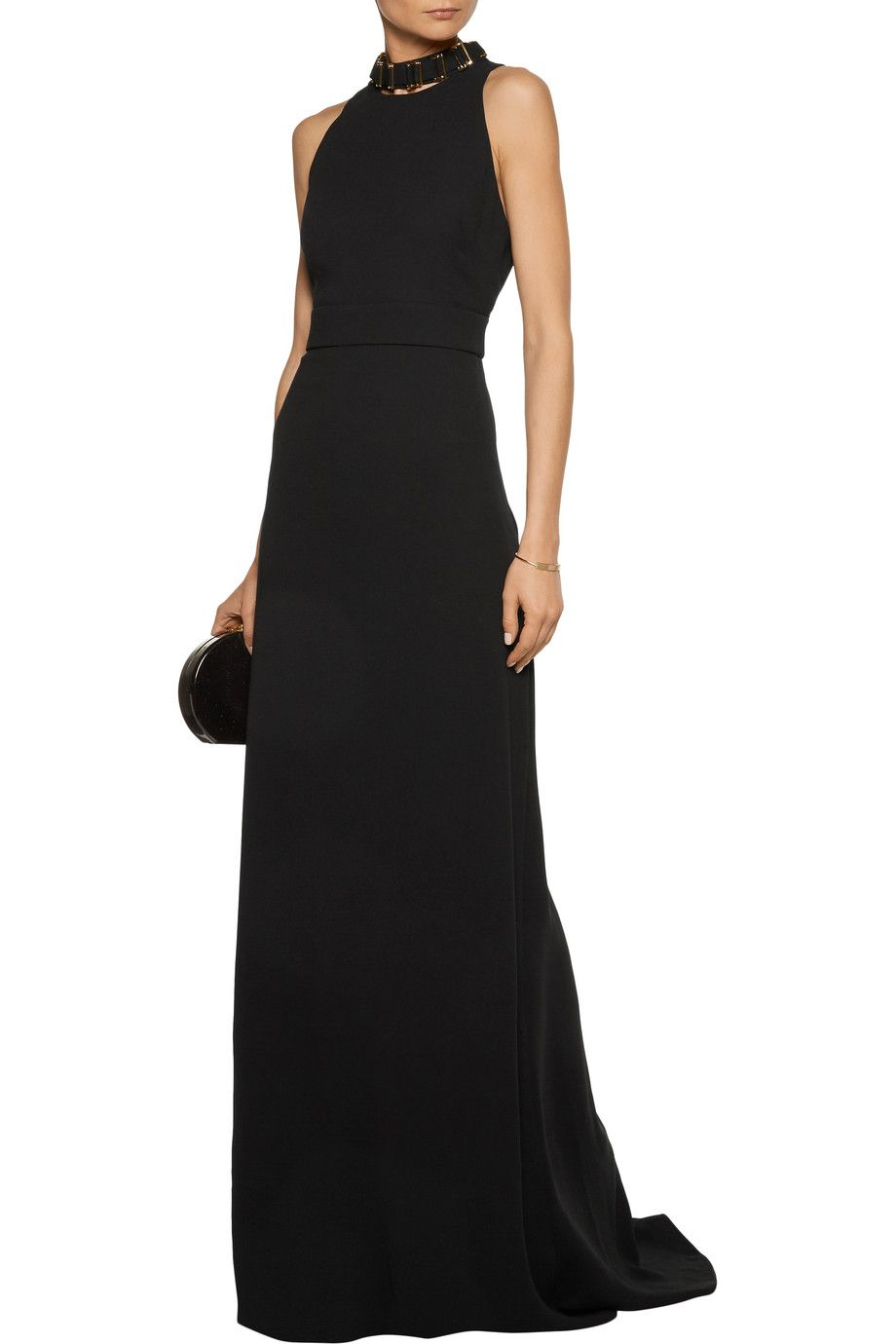 A model wearing a formal black gown