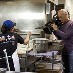 The Unique Eats film crew film in the kitchen at Hash House A Go Go.