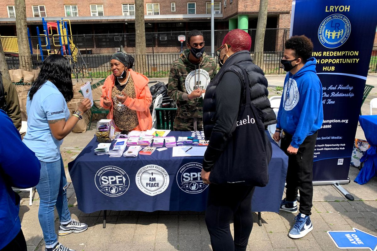 Street Corner Resources set up a booth at the Family Support Services Resource Fair at the St. Nicholas Houses in Harlem on April 9, 2021, after the killing of 10-year-old Ayden Wolfe.