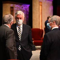 Elder Neil L. Andersen, Elder Dieter F. Uchtdorf and Elder David A. Bednar converse in the Conference Center Theater before the Saturday morning session of the 190th Semiannual General Conference of The Church of Jesus Christ of Latter-day Saints on Oct. 3, 2020.