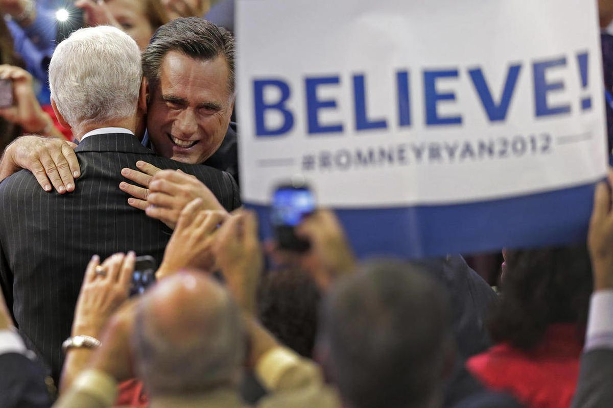 Republican presidential nominee Mitt Romney hugs a supporter as he walks to the stage during the Republican National Convention in Tampa, Fla., on Thursday, Aug. 30, 2012.