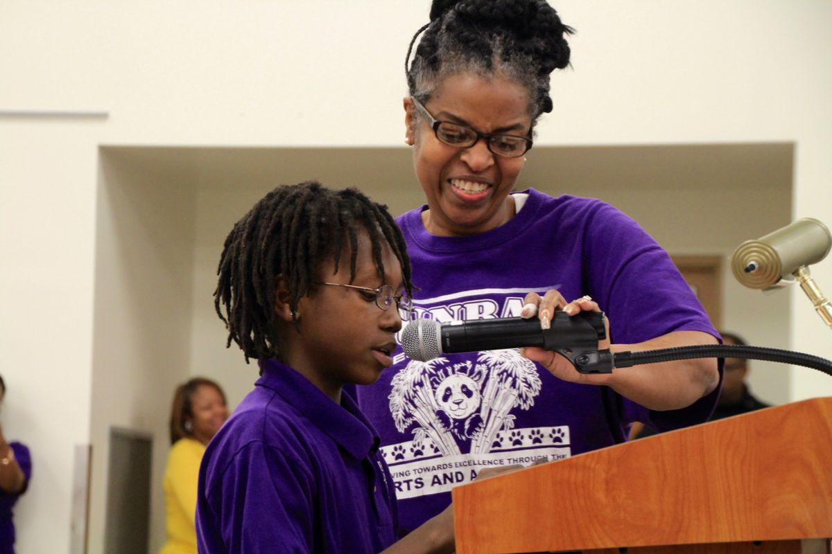 Khamari McElroy, fifth-grade student president at Dunbar Elementary School, asks school board members to keep his school open.