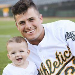 Oakland A's centerfielder Jaycob Brugman with his son, Beck Brugman.