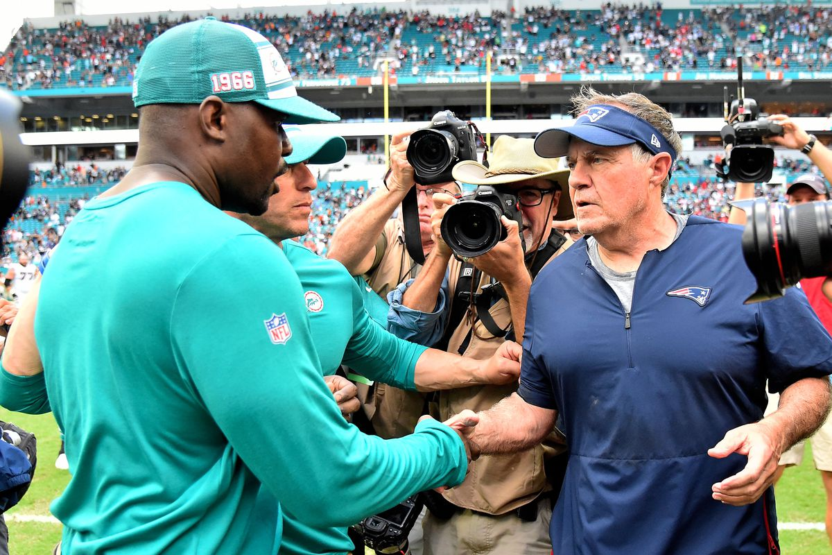 Miami Dolphins head coach Brian Flores greets New England Patriots head coach Bill Belichick after their Week 2 contest at Hard Rock Stadium.