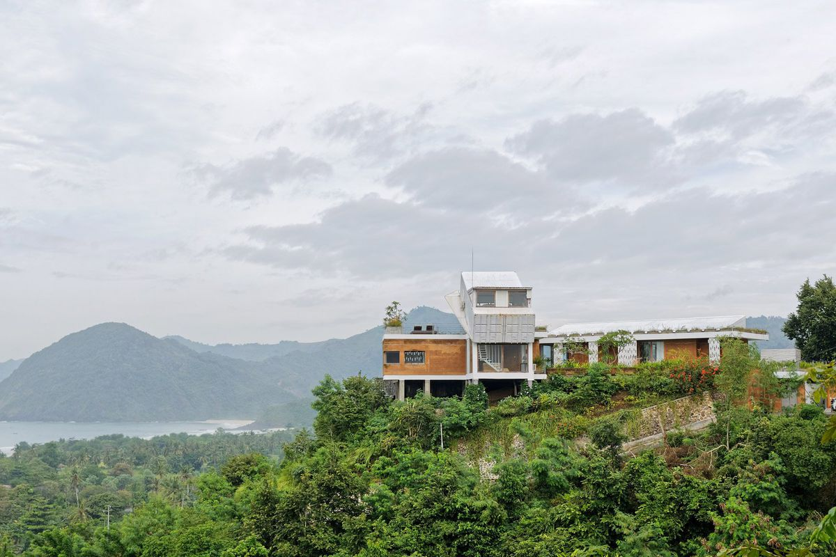 house with slanted shipping container