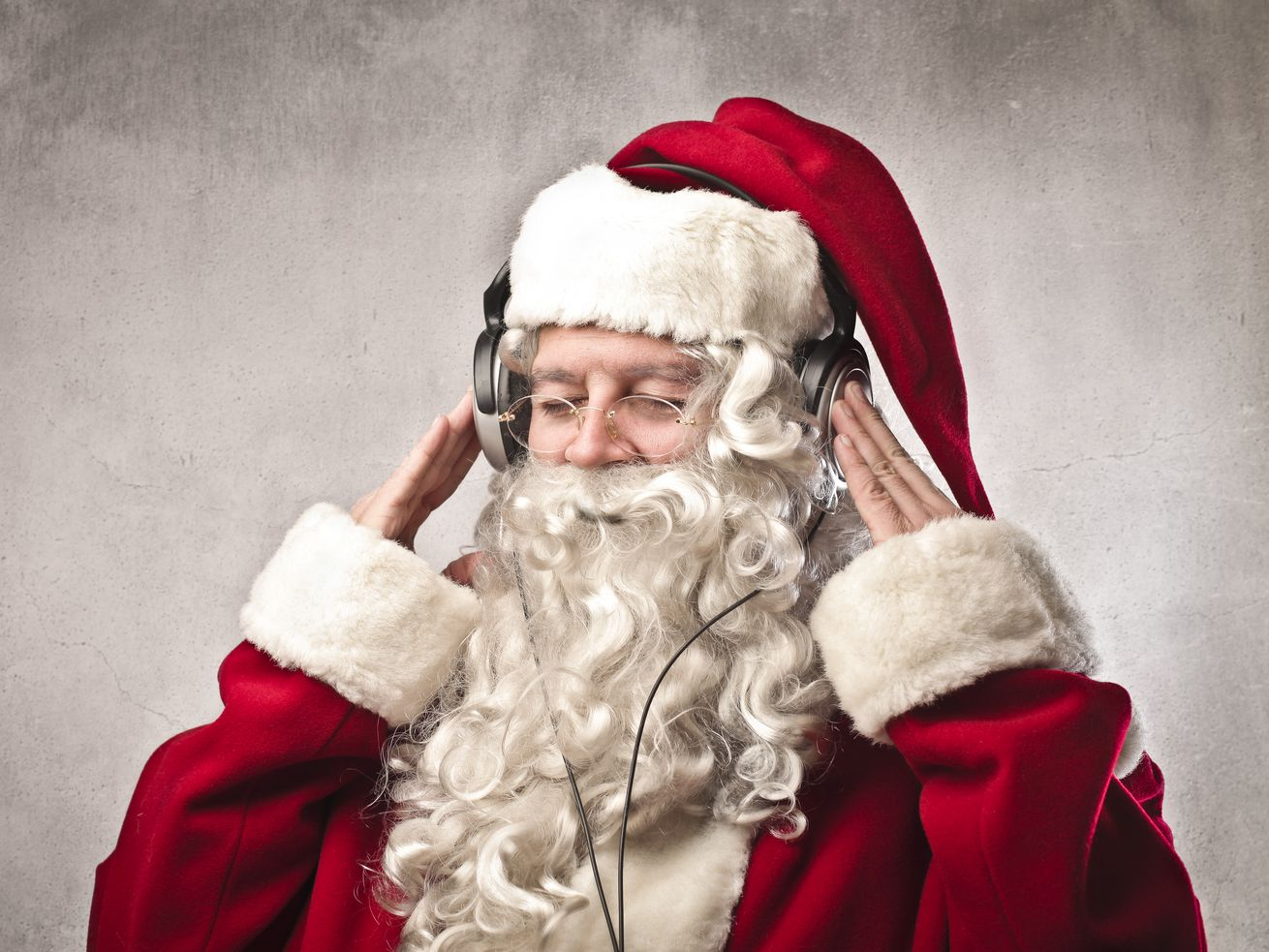 Santa listens to some awesome Christmas tunes.
