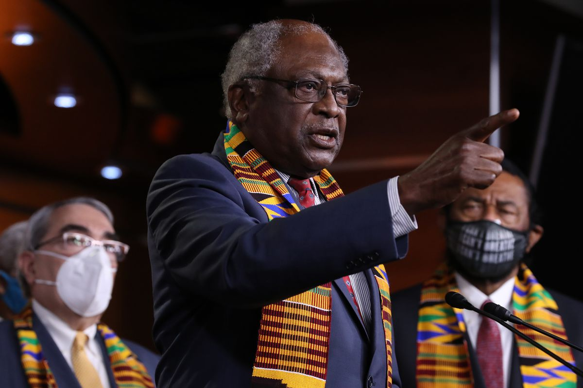 Rep. Jim Clyburn speaking at a lectern and pointing toward the audience.