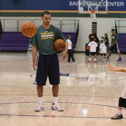 Trey Lyles works on passing skills with David Watson, left, and Alex Clark as Utah Jazz 2015 draft picks Trey Lyles and Olivier Hanlan work on basketball skills with children of members of the Utah National Guard who are either deployed or injured as part of the Utah Jazz and NBA Cares Hoops for Troops program, designed to support and recognize military men and women as well as to strengthen the local community by giving back through special events  June 27, 2015, in Salt Lake City.