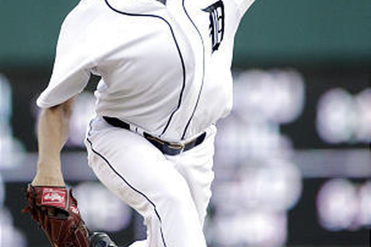 Detroit Tigers starter Jarrod Washburn pitches against the Kansas City Royals.