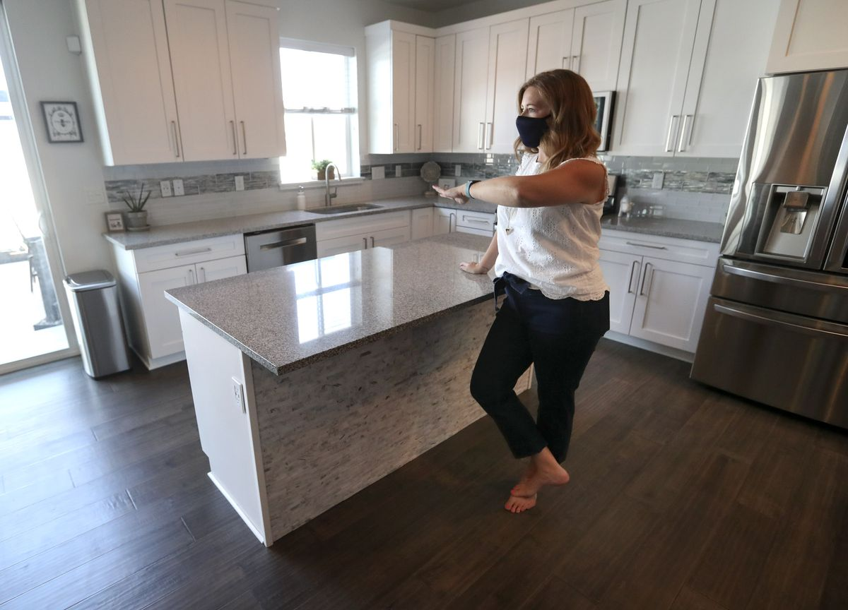 Real estate agent Alicia Holdaway, with Summit Sotheby's International Realty and president of the Salt Lake Board of Realtors, walks through a home for sale in Bluffdale on Monday, July 20, 2020.