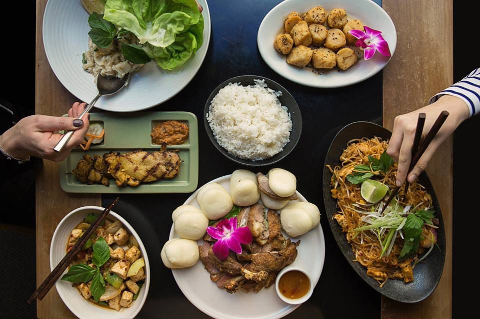 A bird's eye view of various Thanksgiving Asian-influenced dishes from Wild Ginger, including noodles, rice, and vegetables.